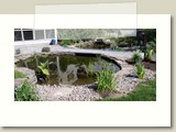 these  ponds and waterfall provide a beautiful entrance to the home
